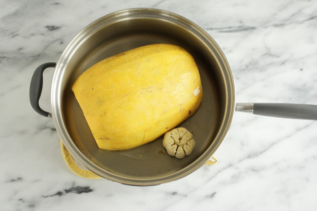 Spaghetti squash with garlic sauce on the stovetop in Kitchen Charm waterless cookware