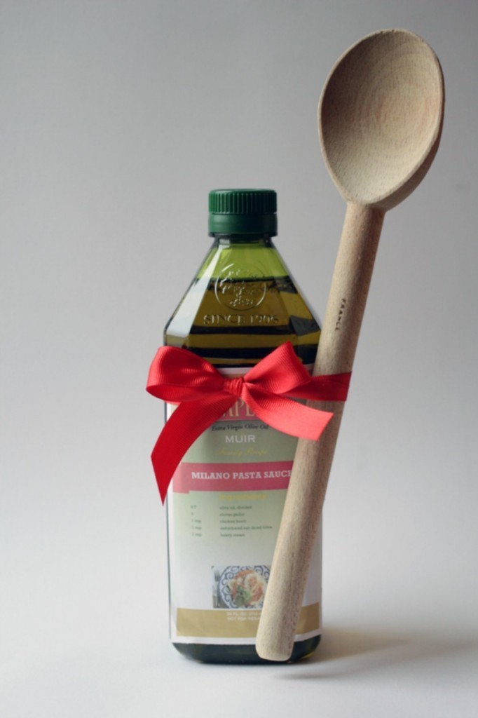 Olive oil Christmas Gift with wooden spoon and ribbon